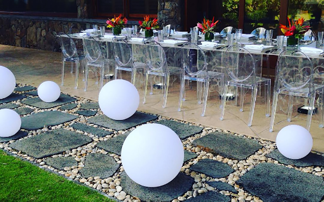 Dinner party setup with clear acrylic table chairs
