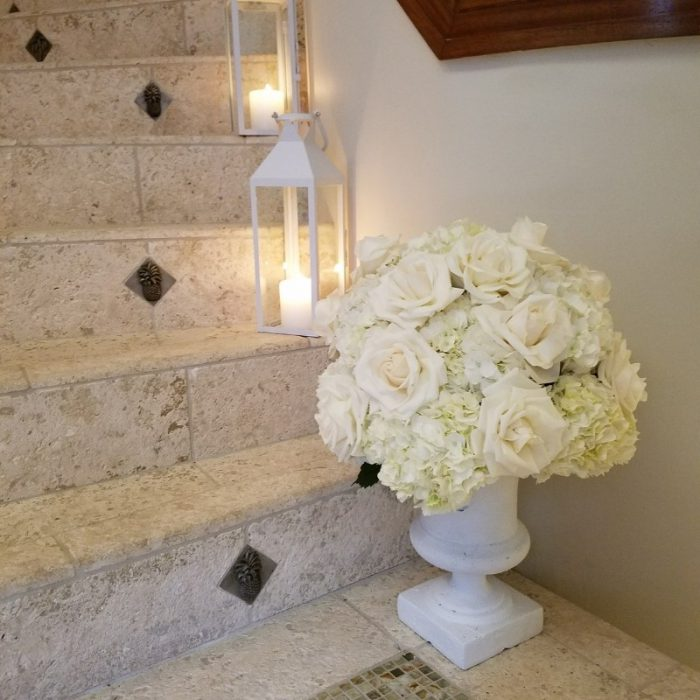 White lantern with candle on stairs