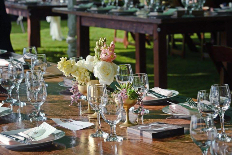 Tabletop scene with flowers and place settings
