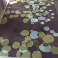 brown-and-green-circles-area-rug-300x163-e1480116653968
